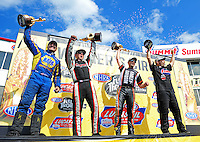 May 6, 2012; Commerce, GA, USA: NHRA pro winners (from left) Ron Capps  (funny car), Steve Torrence (top fuel), Eddie Krawiec (pro stock motorcycle) and Greg Anderson (pro stock)celebrate after winning the Southern Nationals at Atlanta Dragway. Mandatory Credit: Mark J. Rebilas-