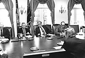 United States President Jimmy Carter returned from Camp David, the Presidential retreat near Thurmont, Maryland, to meet with his National Security Council concerning the crisis in Iran and the Soviet invasion of Afghanistan in the Cabinet Room of the White House in Washington, DC on January 2, 1980.  Pictured with the President are US Secretary of State Cyrus Vance, left, and Secretary of Defense Harold Brown, center right.  In response to the crisis only United Nations sanctions have been proposed but members of the Carter Administration are considering other measures to gain the release of the American hostages in Iran and sanctions against the Soviets for invading Afghanistan.<br /> Mandatory Credit: Jack Kightlinger / White House via CNP