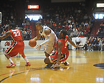 Mississippi guard Trevor Gaskins (23) drives as Georgia's Jeremy Price (50) defends at the C.M. &quot;Tad&quot; Smith Coliseum in Oxford, Miss. on Saturday, January 15, 2011.  (AP Photo/Oxford Eagle, Bruce Newman)
