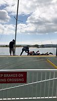 BNPS.co.uk (01202 558833)<br /> Pic: AlanDobson/BNPS<br /> <br /> Beattie grabs the first child...<br /> <br /> A dramatic video captures the moment former England striker James Beattie lept into action at the weekend to help a female sailor and her two children trapped under the Sandbanks ferry in Poole.<br /> <br /> The ex-Everton and Rangers striker leapt into action when he heard a woman shout out 'get my children off' as she feared the 25ft boat was about to sink.<br /> <br /> Mr Beattie, 38, and three other passengers jumped a barrier at the end of the small car ferry in Poole and rushed to the edge of a ramp and hauled the crying children to safety.<br /> <br /> Their shaken mother was then helped off the boat.