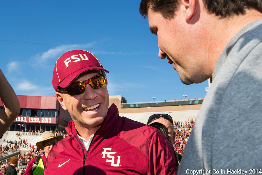 TALLAHASSEE, FL 11/29/14 FSU-UF112914-Florida State Head Coach Jimbo Fisher, left, greets University of Florida Coach Will Muschamp prior to the game Saturday at Doak Campbell Stadium in Tallahassee. <br /> COLIN HACKLEY PHOTO