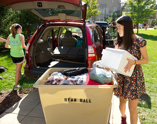 Aug. 23, 2013; Ryan Hall staff help with move-in day.<br /> <br /> Photo by Matt Cashore/University of Notre Dame