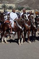 Mudayrib, Oman, Arabian Peninsula, Middle East - Horsemen.  A parade of horses is part of the festivities at the Eid al-Adha (Feast of the Sacrifice), the annual feast through which Muslims commemorate God's mercy in allowing Abraham to sacrifice a ram instead of his son, to prove his faith.