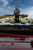 Terremoto del L'Aquila un' anno dopo. Earthquake L'Aquila one year after.Settimio Perilli allevatore di ovini e equini davanti le macerie della casa dei suoi genitori..Settimio Perilli farmer of sheep and horses in front of the rubble of his parents' house...