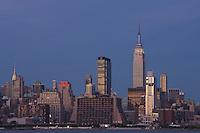 WEEHAWKEN, NJ - JULY 4: The Empire State Building and Manhattan skyline, as seen from Weehawken, NJ, prior to the annual Macy's Fourth of July fireworks on Saturday, July 4, 2009.