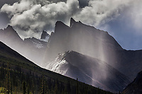 Dramatic clouds over Parabala Peak in the Arrigetch Peaks, Gates of the Arctic National Park, Alaska.