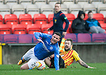 Partick Thistle v St Johnstone....25.10.14   SPFL<br /> Michael O'Halloran is fouled by Jordan McMillan<br /> Picture by Graeme Hart.<br /> Copyright Perthshire Picture Agency<br /> Tel: 01738 623350  Mobile: 07990 594431
