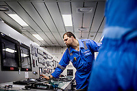 Second engineer Oleksander Gaponov in the engine room of the Mary Maersk, the largest container ship in the world.