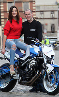21/02/'11 World Champion Street Bike Freestyle Rider, Mattie Griffin (from Galway) with model Lily Greibre pictured on his BMW F800R this afternoon at Smithfield Square where he demonstrated some of his skills and stunts at the launch of the 'ZUP', the world's first motorcycle clothing connector system. ZUP allows riders to turn their favourite riding gear, leather into a suit by connecting trousers with jacket at the waist. The system was developed by two Irish bikers, Doreen Connaughton and Frank Mullen..Picture Colin Keegan, Collins, Dublin.