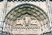 Chartres: Chartres Cathedral--Tympanum, Central Portal, Chirst in Glory, surrounded by symbols of the four Evangelists: Angel of Matthew, Lion of St. Mark, Eagle of John, Bull of Luke. Photo '87.