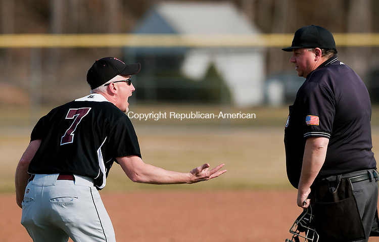 TORRINGTON,  CT,  CT-041315JS10- Torrington head coach Pat Richardson argues with the umpire after, what appeared to be a home run by Torrington's Kobe Covington, was ruled a ground-rule double during their game against Holy Cros Monday at Fuessenich Park in Torrington.<br /> Jim Shannon Republican-American