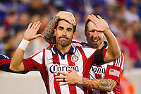 Juan Pablo Angel (9) of CD Chivas USA holds his hands up after scoring as Danny Califf (23) celebrates. The New York Red Bulls and CD Chivas USA played to a 1-1 tie during a Major League Soccer (MLS) match at Red Bull Arena in Harrison, NJ, on May 23, 2012.