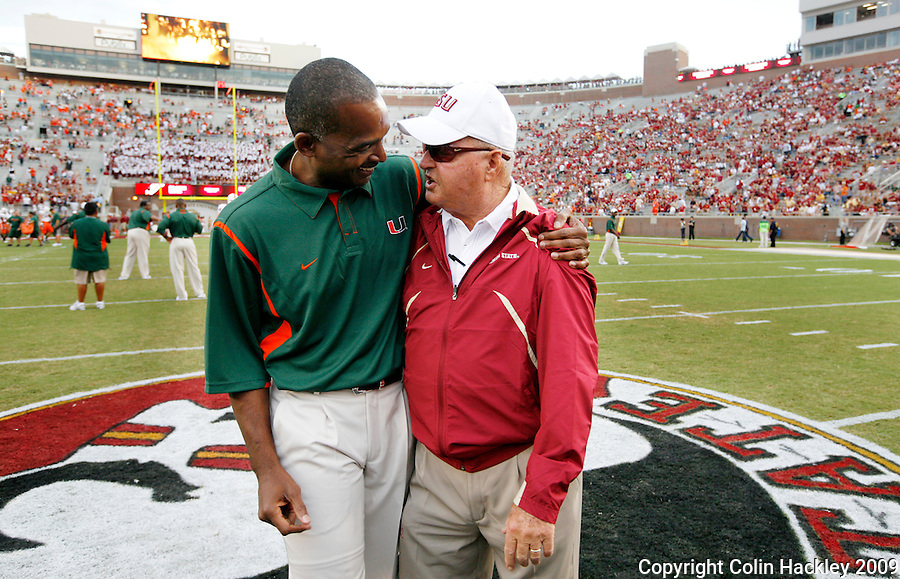 TALLAHASSEE, FL 9/7/09-FSU-MIAMIFB09 CH42-Florida State Head Coach Bobby Bowden, right, talks with Miami Head Coach Randy Shannon prior to the game Monday at Doak Campbell Stadium in Tallahassee. The Seminoles lost to the Hurricanes 38-34...COLIN HACKLEY PHOTO