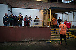 Prescot Cables 2 Brighouse Town 1, 13/02/2016. Hope Street, Northern Premier League. Spectators in the enclosure applauding their team from the pitch at the end of the game as Prescot Cables (in orange) take on Brighouse Town in a Northern Premier League division one north fixture at Valerie Park. Founded in 1884, the 'Cables' in their name came from the largest local employer, British Insulated Cables and they have played in their current ground, also known as Hope Street, since 1906. Prescott won the match 2-1 watched by a crowd of 189. Photo by Colin McPherson.
