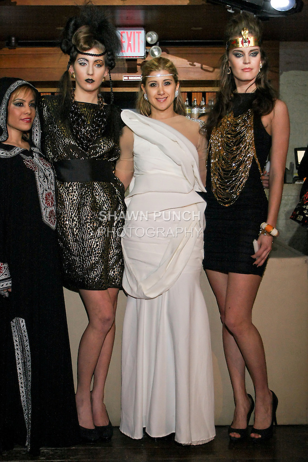 "Fashion stylist Engie Hassan (white dress), poses with models during the EngieStyle one year anniversary, ""A Tale of the Black Dress"", fashion presentation."