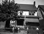 Wilkinsburg PA: View of the Stewart's house with Brady Jr, Helen, Sally and friend playing in the front yard - 1927. Stewart's lived at 1007 East End Avenue in Wilkinsburg.  During the 1920s and 1930s, Wilkinsburg was a growing community for the emerging middle class of Pittsburgh.