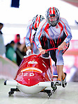 18 December 2010: Dawid Kupczyk starts up his 2-man bobsled for Poland, finishing in 14th place at the Viessmann FIBT World Cup Bobsled Championships on Mount Van Hoevenberg in Lake Placid, New York, USA. Mandatory Credit: Ed Wolfstein Photo
