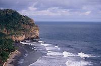 Waves breaking on the rugged Costa del Balsamo in western El Salvador, Central America