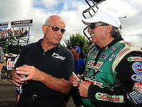 Aug. 7, 2011; Kent, WA, USA; NHRA funny car driver Gary Densham (left) with John Force during the Northwest Nationals at Pacific Raceways. Mandatory Credit: Mark J. Rebilas-
