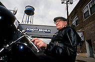 "Perth Amboy, New Jersey, U.S.A, February, 1989. Irving Schott, 98, the founder of  ""Perfecto"" factory where the famous leather jackets are made. Bomber pilots and Harley-Davidson buffs adopted them, as did James Dean and Elvis Presley."