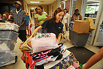 Morgan Leigh Dykes, center, of Montgomery, Ala. moves her belongings  into Stockard-Martin Dorm at the University of Mississippi in Oxford, Miss. on Friday, August 19, 2011. Classes begin on Monday, August 22, 2011. (AP Photo/Oxford Eagle, Bruce Newman)