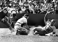 Giants catcher Milt May tags the foot of <br />