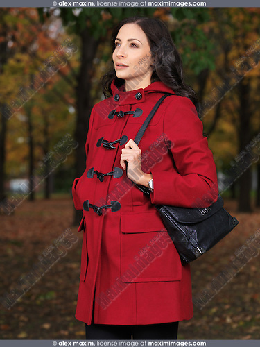 Fall fashion photo of a Beautiful young woman wearing a red coat