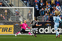 Sebastien Le Toux (11) of the Philadelphia Union shoots wide as Sporting Kansas City goalkeeper Jimmy Nielsen (1) defends during the first half during a Major League Soccer (MLS) match at PPL Park in Chester, PA, on March 2, 2013.
