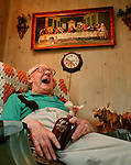 Dick Thompson laughs heartily from his favorite chair while telling one of his famous stories. He has been a member of the Moose Lodge for 56 years and along the way aquired a diverse collection of memorabilia.
