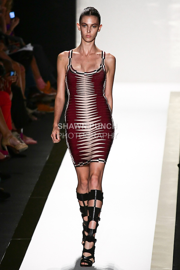 Ruby walks the runway in a port jacquard bandage dress, with black gladiator boot, by Max Azria for the Herve Leger by Max Azria Spring 2012 fashion show, during Mercedes-Benz Fashion Week Spring 2012.