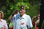 A veteran salutes at the dedication of the new Veterans Park in Oxford, Miss. on Saturday, June 30, 2012.