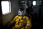 "U2 pilot Major Eric Shontz rides in a van to the flightline for a ""high-flight"" at Beale Air Force Base February 24, 2010 in Linda, Calif."