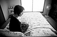 48 year old Hideko Shimamura looks at the empty side of the bed where her late husband Msayoshi Shimamura used to sleep in Saitama. He committed suicide in 2009, from depression brought on by excessive overwork. The word karoshi (literally death by overwork) came into common use around 1990, when Japanese workers began working longer hours in response to competition from overseas and the recession at the time. Despite increased awareness of the dangers of overwork, de-regulation and increased global competition means that Japanese workers are working harder than ever. About 20 years ago, heart attacks or strokes were a symbol of 'karoshi' in Japan.  Today, a major change is workers are committing suicide. .