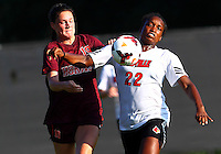 WINSTON-SALEM, NORTH CAROLINA - August 30, 2013:<br /> Christine Exeter (22)  of Louisville University pushes past Jordan Coburn (19) of Virginia Tech during a match at the Wake Forest Invitational tournament at Wake Forest University on August 30. The game ended in a 1-1 tie.
