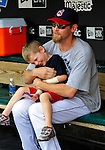 6 September 2009: Cleveland Indians' relief pitcher Kerry Wood plays in the dugout with his son Justin prior to a game against the Minnesota Twins at Progressive Field in Cleveland, Ohio. The Indians defeated the Twins 3-1 to take the rubber match of their three-game weekend series. Mandatory Credit: Ed Wolfstein Photo