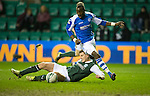 Hibs v St Johnstone.....11.02.13      SPL.Gregory Tade and Paul Hanlon.Picture by Graeme Hart..Copyright Perthshire Picture Agency.Tel: 01738 623350  Mobile: 07990 594431