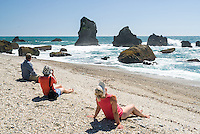 Family enjoying remote beach in summer, West Coast, South Westland, New Zealand