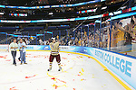 07 APR 2012:  Johnny Gaudreau (13) of Boston College gives his hockey stick to a fan after their victory against Ferris State University during the Division I Men's Ice Hockey Championship held at the Tampa Bay Times Forum in Tampa, FL.  Boston College defeated Ferris State 4-1 to win the national title.  Matt Marriott/NCAA Photos