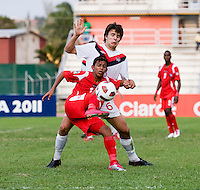 Parker Seymour (6) of Canada stays tight to Darwin Pinzon (10) of Panama during the semifinals of the CONCACAF Men's Under 17 Championship at Catherine Hall Stadium in Montego Bay, Jamaica. Canada defeated Panama, 1-0.
