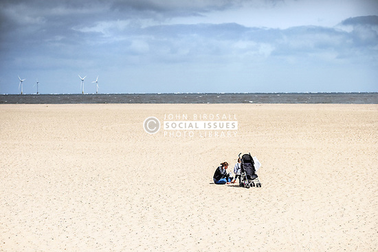 A mother and her child on the beach at Great Yarmouth. Norfolk UK