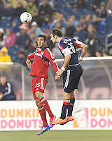 Chicago Fire midfielder Orr Barouch (15) and New England Revolution midfielder Stephen McCarthy (26) battle for head ball. In a Major League Soccer (MLS) match, the New England Revolution defeated Chicago Fire, 2-0, at Gillette Stadium on June 2, 2012.