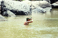 Ivan Alechine crossing the river at the bottom of the barranca (canyon) to get to a Cora village. Cora and Wixarika (Huichol) community in the Sierra Madre Occidental, Mexico