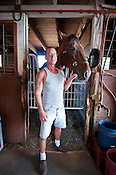 Editorial photo of Horse trainer, owner with horse in barn at the Fairgrounds stables in Montgomery County Ohio