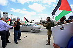 Palestinian protesters scuffle with Israeli soldiers during a demonstration in support of prisoners refusing food in Israeli jails at the Hawara checkpoint, south of Nablus in the Israeli-occupied West Bank, on May 23, 2017, during a visit of the US president to Israel and the Palestinian territories. A general strike in support of Palestinian hunger strikers in Israeli prisons, coincided with Trump's arrival in Israel and the Palestinian territories. Photo by Ayman Ameen