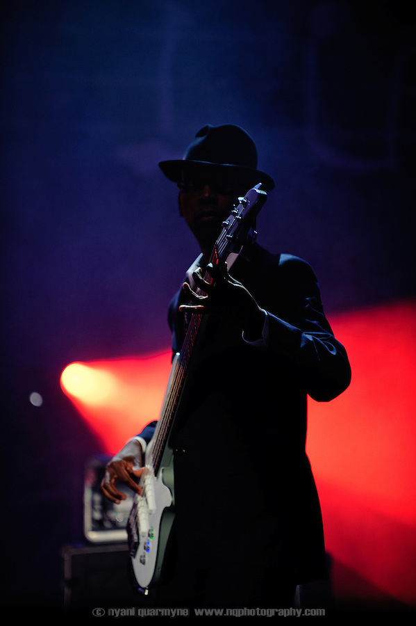 Bass Guitarist Michael Mondesir performing with British Nigerian soul singer Ola Onabule at the Montreal Jazz Festival in Montreal, Canada on 6 July 2009.