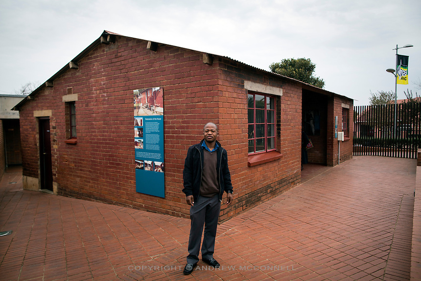 Lebo Khumalo, 28, from the Limpopo region, pictured outside the former house of Nelson Mandela, in Soweto, Johannesburg. Mandela lived in the house from 1946 until 1962 and briefly returned here after his release from prison.