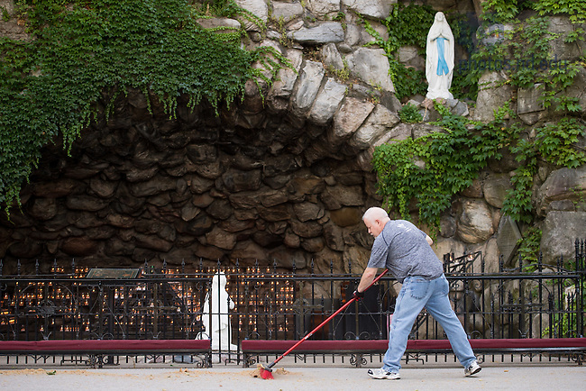 June 12, 2016; Tim Malott, Grotto caretaker, sweeps up around the Grotto.  He says he pauses when visitors stop by for prayer. (Photo by Matt Cashore/University of Notre Dame)