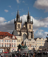 Old Town Square or Staromestske namesti with the Jan Hus Memorial by Ladislav Saloun, 1915, and the Tyn Church or Church of Our Lady before Tyn, built 14th - 15th centuries in the late Gothic style, with multiple spires on each tower, Prague, Czech Republic. The historic centre of Prague was declared a UNESCO World Heritage Site in 1992. Picture by Manuel Cohen