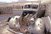 A Moudjahidin in what remain of the King Packard Twelve car, in the courtyard of the Afghan Kabul National museum in Spring 1995.