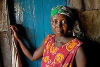 Kroo Bay, Freetown, Sierra Leone...Story on child and maternal health in the Kroo Bay slum community in Freetown, Sierra Leone, which has the World's worst infant and maternal mortalitly rates. One in 4 children die before they reach the age of 5 and one in 6 mothers dies during child birth (in the UK, the rate is one in 3,800)...The Kroo Bay Community Health Centre has a catchment area of over 8,000 people but lacks adequate facilites to provide even basic care. The clinic lacks even the basics, such as bedpans, surgical spirits and cotton wool. It has no electricity and clean drinking water must be fetched from the nearby well everyday...Mariatu Bangura, a traditional birth attendent...© 2007 Aubrey Wade. All rights reserved.